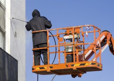 a worker in a cherry-picker